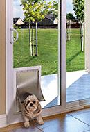 Analin sliding patio door with pet door
